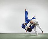 Two men fighting judo