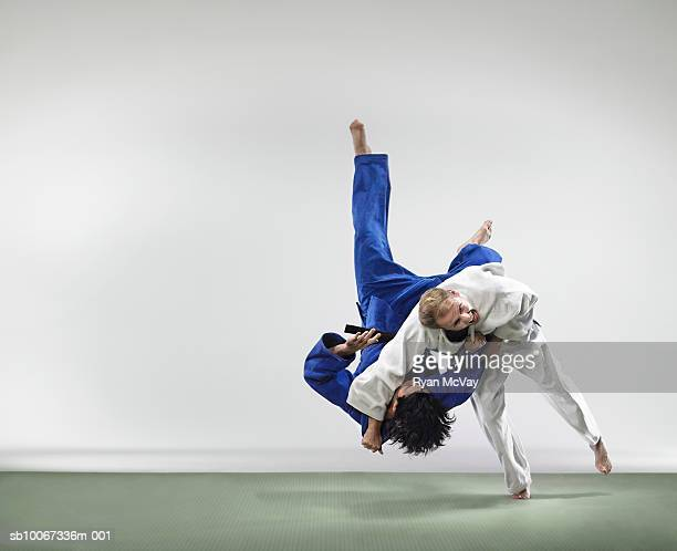 Two men fighting judo