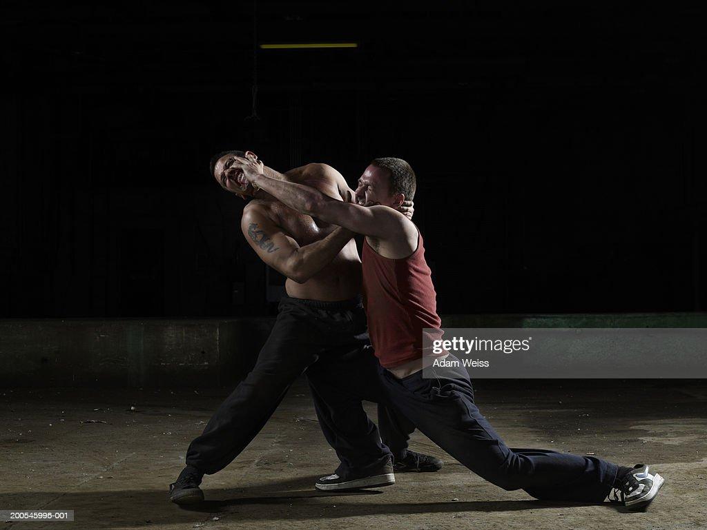 Two men fighting : Stock Photo