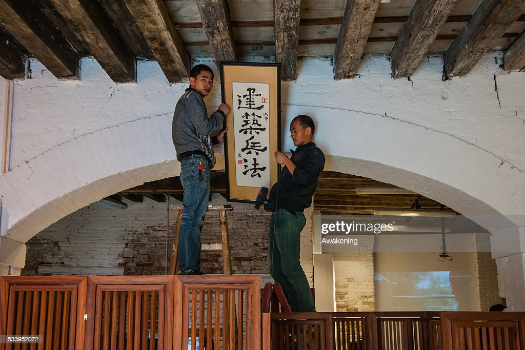 Two men finish to prepare the Hong Kong pavilion at the 15th Architecture Venice Biennale, on May 24, 2016 in Venice, Italy. The 56th International Architecture Exhibition of La Biennale di Venezia will be open to the public from May 28, 2016 in Venice, Italy.