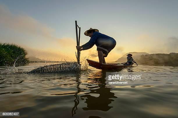 Two men fishing, Bangpra Lake, Thailand