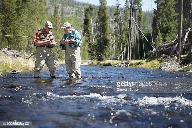 2 people fishing stock photos and pictures getty images for Videos of people fishing