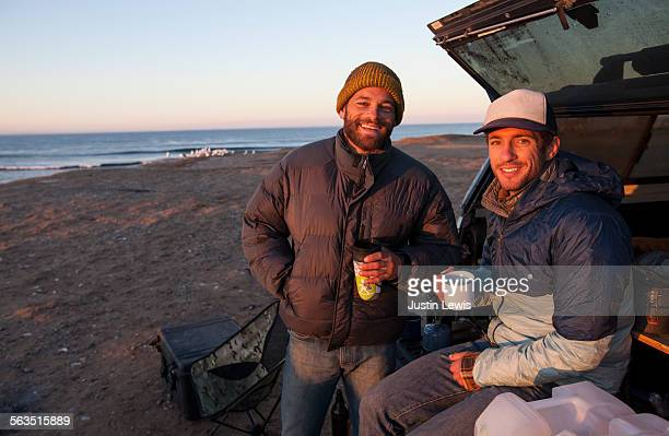 Two Men Friends at Beach Campsite Drinking Coffee
