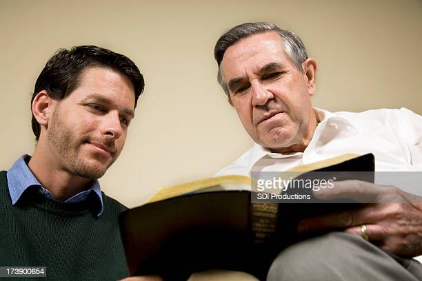 Two men happily studying the Bible together