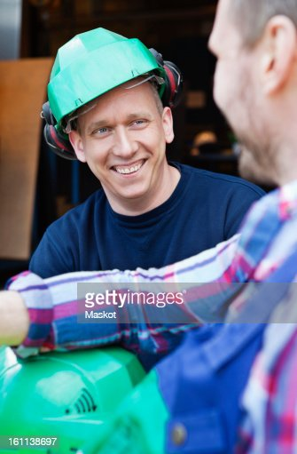Two men having a chat and laughing : Stock Photo