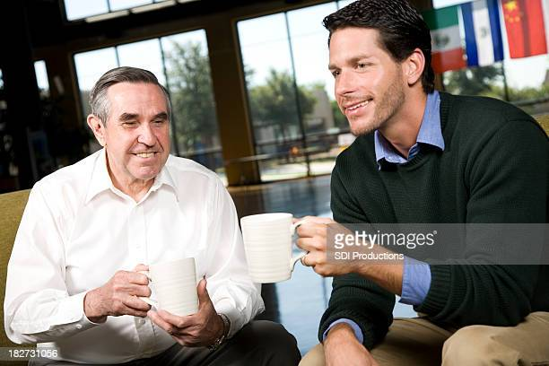Two Men Having Coffee together at meeting place