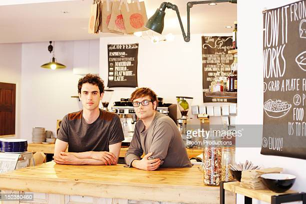 two men in a cafe