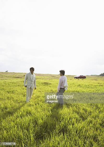 Two men in a field of grass