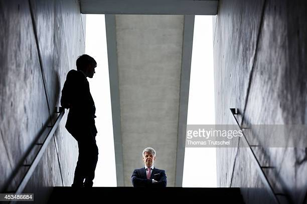 Two men in business business suits at the end of a staircase on August 07 2014 in Berlin Germany