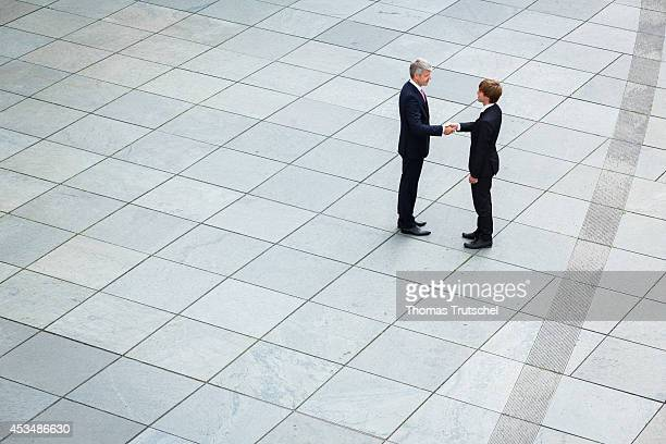 Two men in business business suits shaking hands on August 07 2014 in Berlin Germany