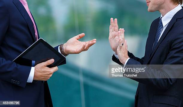 Two men in business suits have a discussion on August 07 2014 in Berlin Germany