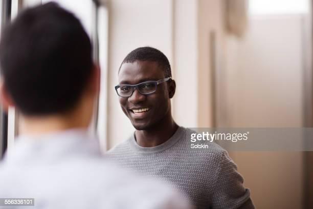 Two men in conversation in office
