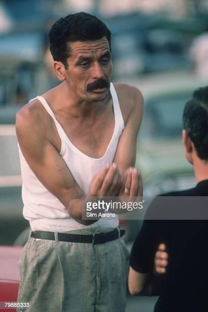 Two men in conversation Palermo Sicily August 1975