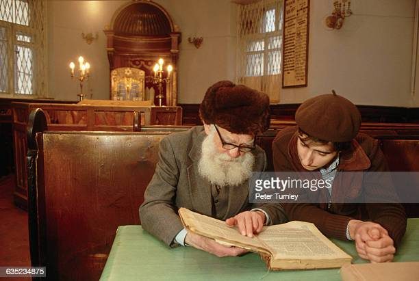 Two men in Moscow's main synagogue read from a book together