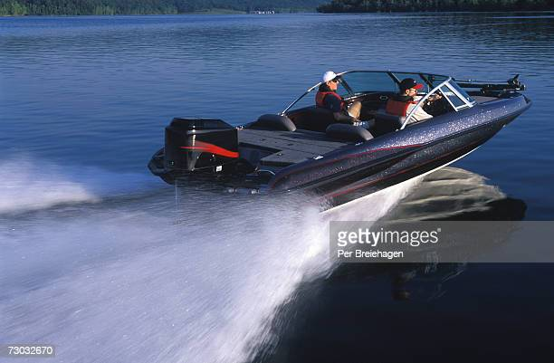 Two men in motorboat on lake, Table Rock Lake, Branson Missouri, USA