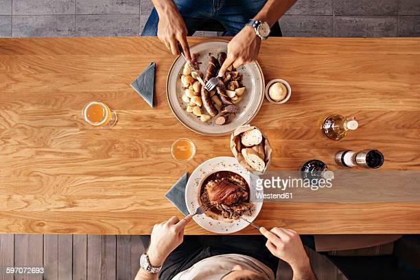 Two men in restaurant having lunch