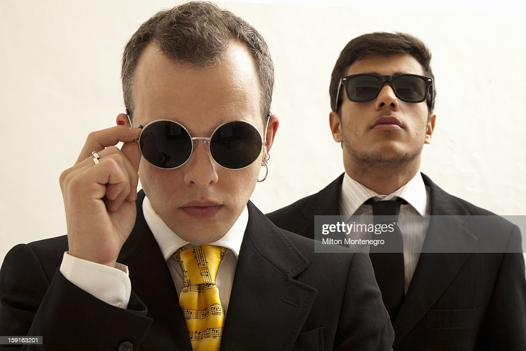 Two men in suits wearing sunglasses. : Stock Photo