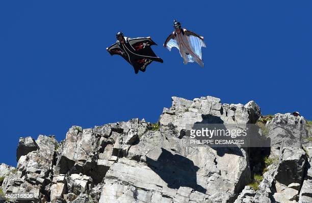 Two men jump from the top of the Brevent mountain to fly in wingsuit over the French ski resort of Chamonix on July 16 2014 AFP PHOTO / PHILIPPE...