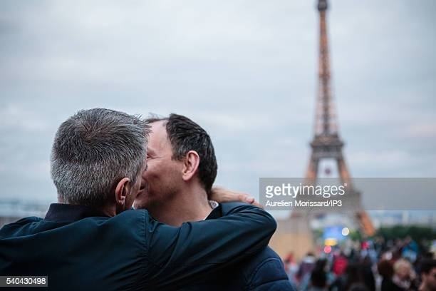 Two men kiss at the gathering on the Place du Trocadero to show their support after the worst mass shooing in United States history on June 13 2016...