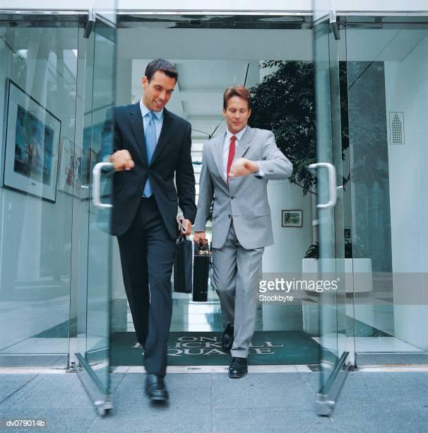 Two men leaving building together