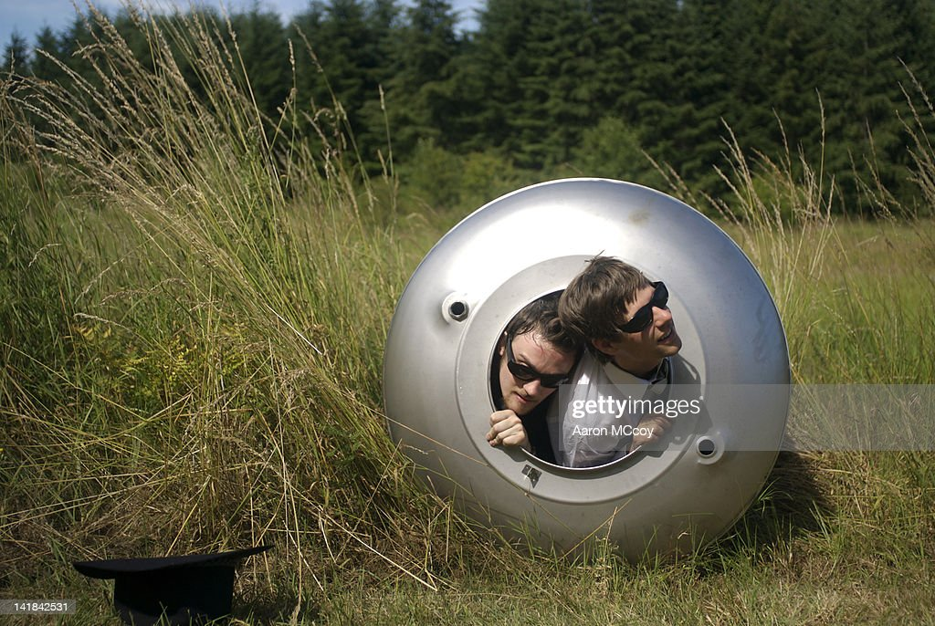 Two men look out of a space capsule, Vashon Island, Washington : Stock Photo