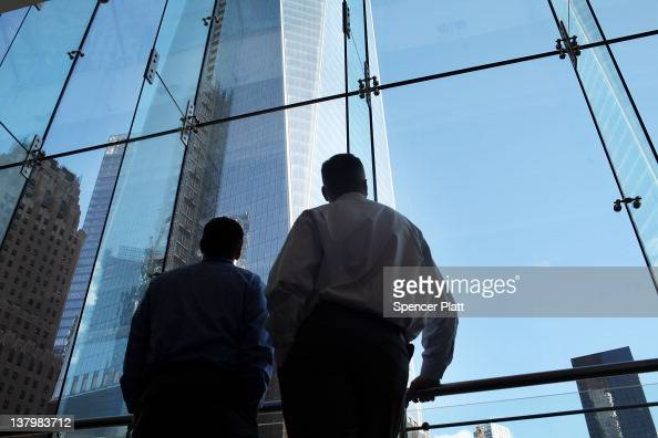 Two men look up at One World Trade Center the central skyscraper under construction at Ground Zero on January 30 2012 in New York City The price tag...