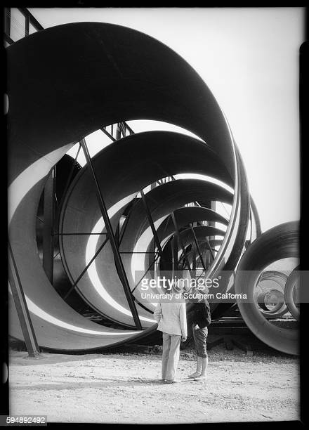 Two men looking at huge pipes for the Hoover Dam dw19344120867~08