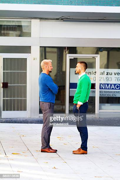 Two men looking each other