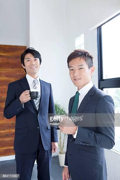 Two men making a pose