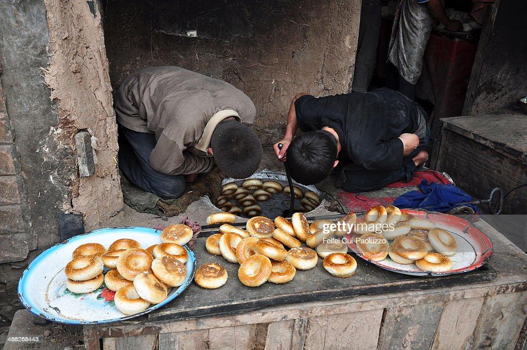 Two Men Making Kashgar Naan bread at old town of Kashgar Xinjiang Province China