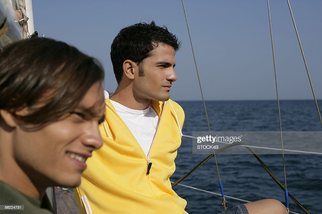 Two men on a sailboat : Stock Photo