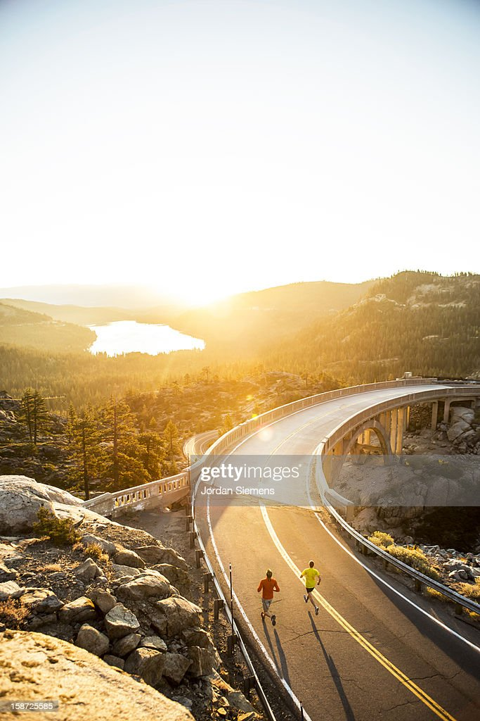 Two men on an early morning run. : Stock Photo