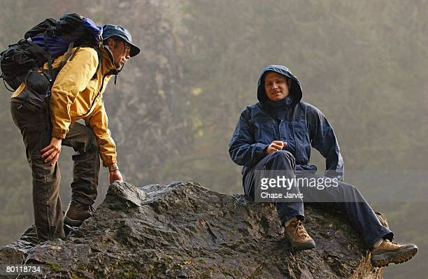 Two men on edge of rocky cliff