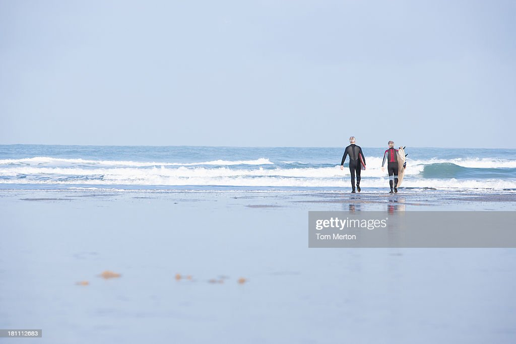 Two men on the beach with surfboards : Stock Photo