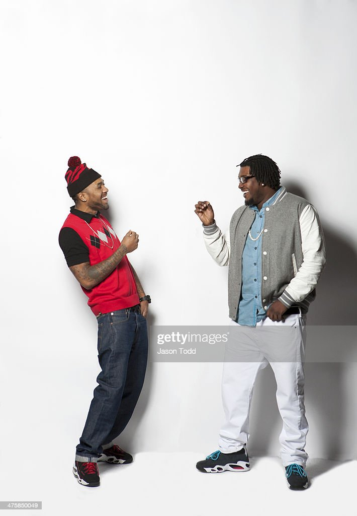 two men on white laughing and making had gestures : Stock Photo