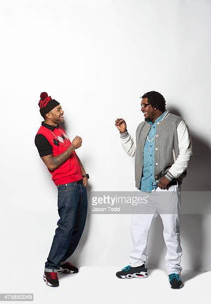 two men on white laughing and making had gestures