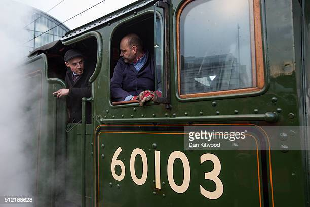 Two men onboard talk to each other as The Flying Scotsman leaves Kings Cross Station on February 25 2016 in London England The Flying Scotsman built...