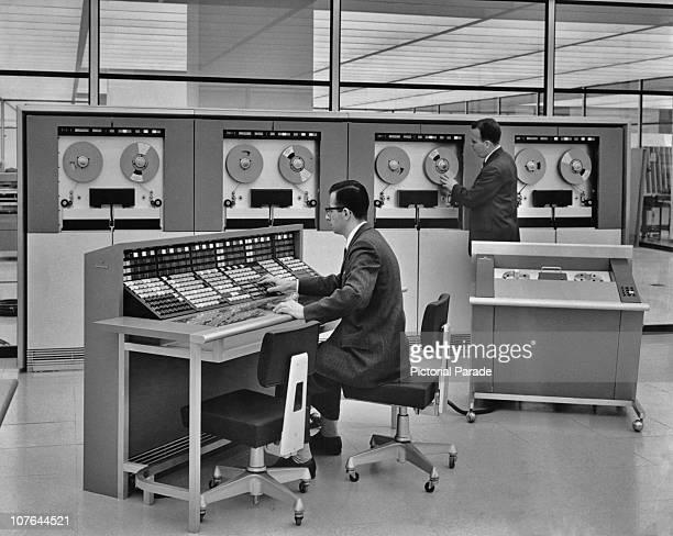 Two men operating a mainframe computer circa 1960