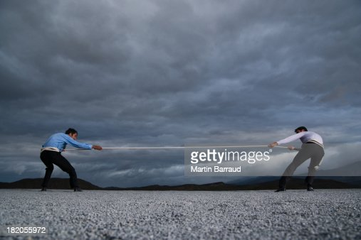 Two men outdoors in tug of war