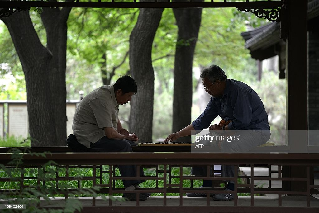 Two men play Chinese chess at a park in Beijing on May 24, 2013.