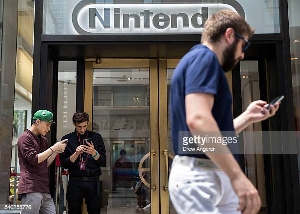 Two men play Pokemon Go on their smartphones outside of Nintendo's flagship store July 11 2016 in New York City The success of Nintendo's new...