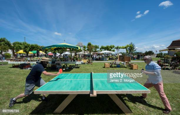 Two men play table tennis at a local fair on June 5 2017 in Saussignac France Monday is a public holiday in France to celbrate the day after...