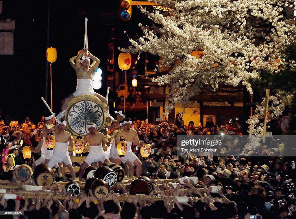 Two men play the big Japanese drum which is carried by hundreds of men during the 'Okoshi Daiko' or Rousing Drum parade, as a part of the Furukawa Festival on April 19, 2014 in Hida, Gifu, Japan. The annual two-day festival is designated as Important Intangible Folk Cultural Property.