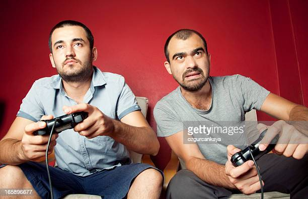 Two men playing a video game together