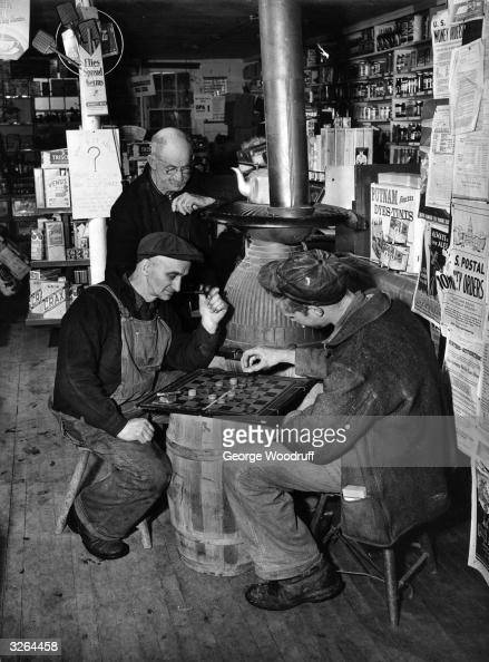 Two men playing checkers or draughts at the annual tournament held at the Stow general store