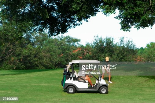 Two men playing golf in a golf course : Stock Photo
