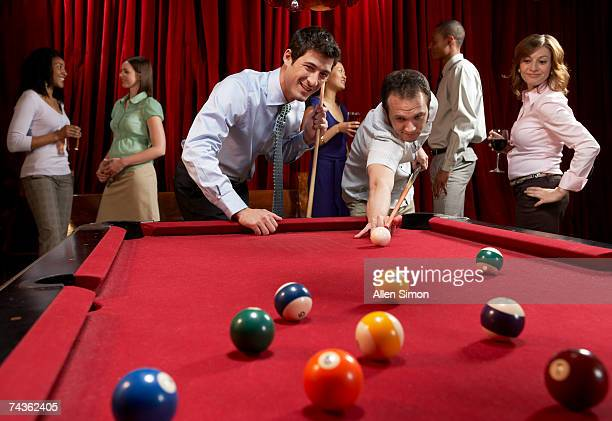 Two men playing pool at pub