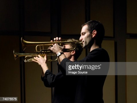 Two men playing trumpets