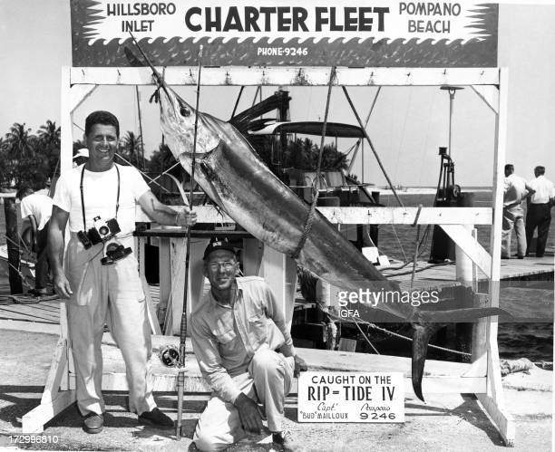 Two men pose on the Hillsboro Inlet Dock next to a white marlin caught on the Rip Tide IV fishing boat near Hillsboro Inlet in Pompano Beach Florida...