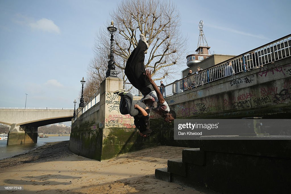 Two men practice 'Free Running' moves on the South Bank on February 18, 2013 in London, England.